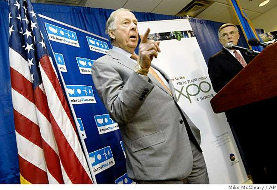 "T. Boone Pickens has delayed a plan to develop a wind farm on thousands of acres in west Texas, citing the drop in natural gas prices. He even trimmed about $10?million from a renewable energy campaign he started to promote wind and natural gas.Texas oilman T. Boone Pickens makes a point during a news conference Monday, Nov. 10, 2008 in Bismarck, N.D., during the opening day of the Great Plains Energy Expo and Showcase. Pickens spoke about his ""Pickens Plan"" for alternative energy sources and for wind energy and the expansion of a national energy infrastructure. To the right is Sen. Byron Dorgan, D-N.D. (AP Photo/Bismarck Tribune, Mike McCleary) Photo: Mike McCleary, AP"