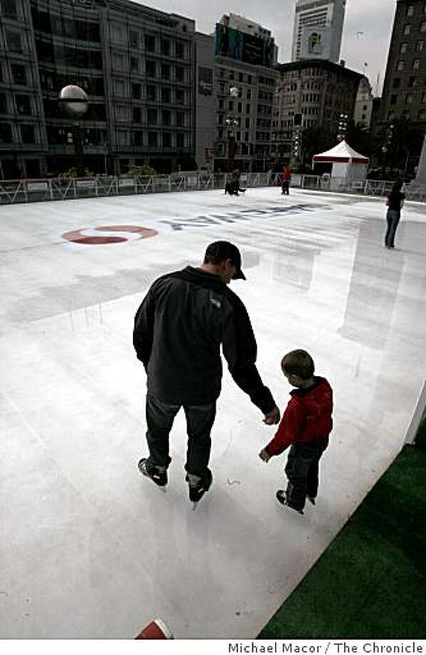 MIke Rommens and his son Austin, 4, of Alberta, Canada make their way onto the ice at the holiday rink in the center of Union square in San Francisco, Calif., on Wednesday, Nov. 12, 2008. Photo: Michael Macor, The Chronicle