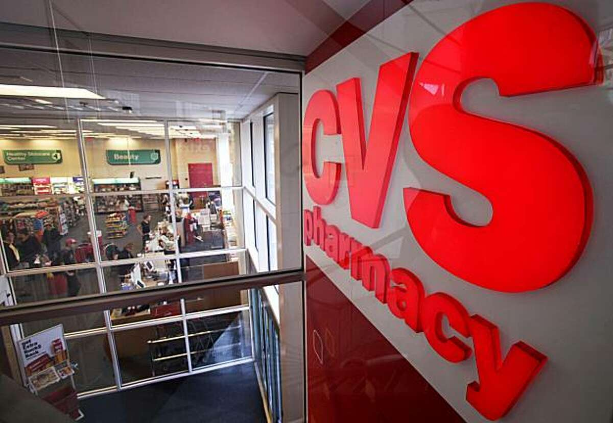 In this Nov. 3, 2009 photo, a CVS pharmacy sign is seen opposite the interior of one of the CVS locations, in Providence, R.I. CVS Caremark Corp. said Thursday, Nov. 5, 2009, its third-quarter profit jumped 39 percent on a boost from pharmacy benefits services and drugstore sales. (AP Photo/Steven Senne)