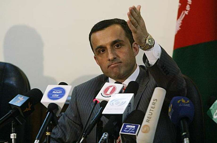 National Directorate of Security chief Amrullah Saleh speaks to the media after submitting his resignation in Kabul, Afghanistan, Sunday, June 6, 2010. The Afghan president's office says Hamid Karzai has accepted the resignations of his interior ministerand intelligence chief over a militant attack on last week's national peace conference. Photo: Ahmad Massoud, AP
