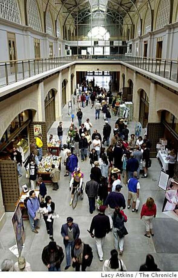 FERRY412_LA.jpg The inside of the renovated San Francisco Ferry Building is now the home of the Farmers Market where thousands flocked to check out the new build as well as the new food booths. Among the booths inside are Scharffer Berger Chocolate and Goldn Gare Meat Company. 4/26/03 in San Francisco. Lacy Atkins/San Francisco Chronicle Photo: Lacy Atkins, The Chronicle