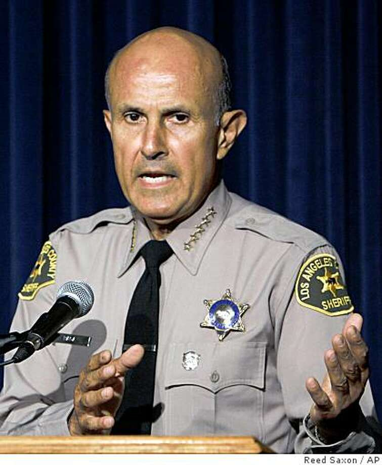 Los Angeles County Sheriff Lee Baca talks about issues related to the incarceration of Paris Hilton at a news conference at Sheriff's Headquarters Bureau in Monterey Park, Calif., Friday, June 8, 2007. (AP Photo/Reed Saxon) Photo: Reed Saxon, AP