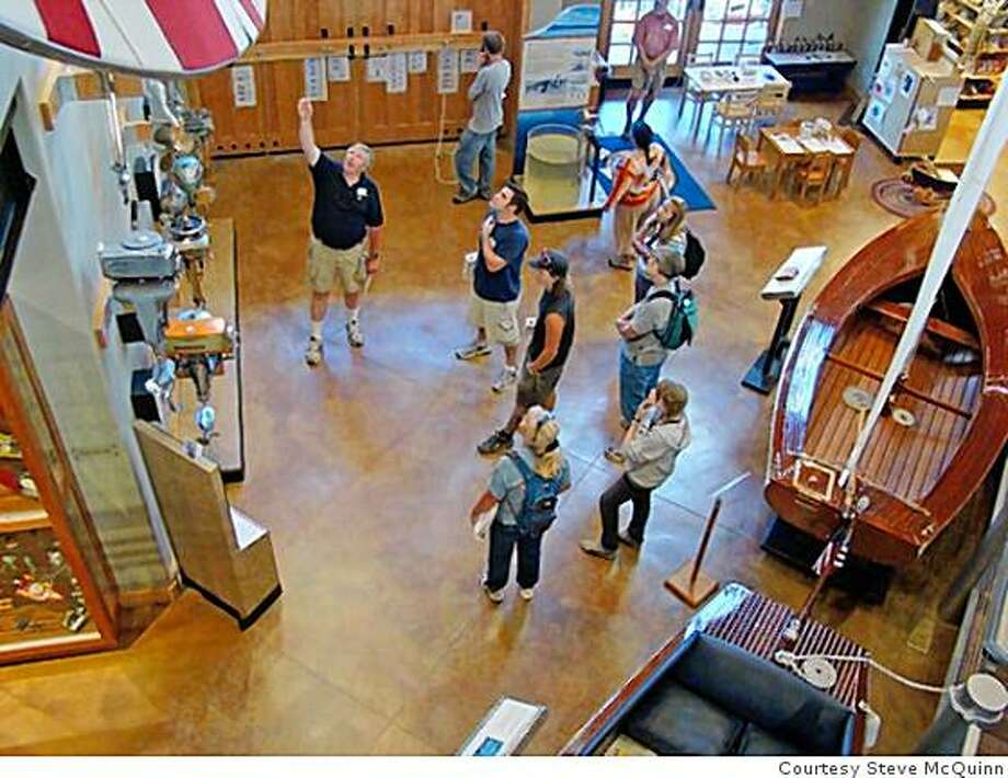 Tahoe Maritime Museum Staff Associate David Smith explains the characteristics of various outboard motors on display to a group of local educators. Photo: Courtesy Steve McQuinn