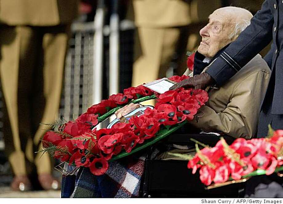 """World War One veteran Henry Allingham, 112, attends an Armistice Day commemoration ceremony in Whitehall in London, on November 11, 2008. Europe on Tuesday marked the 90th anniversary of the end of World War I, with the handful of surviving veterans at the vanguard of commemorations for the fallen of the """"War to End All Wars"""". AFP PHOTO/SHAUN CURRY (Photo credit should read SHAUN CURRY/AFP/Getty Images) Photo: Shaun Curry, AFP/Getty Images"""