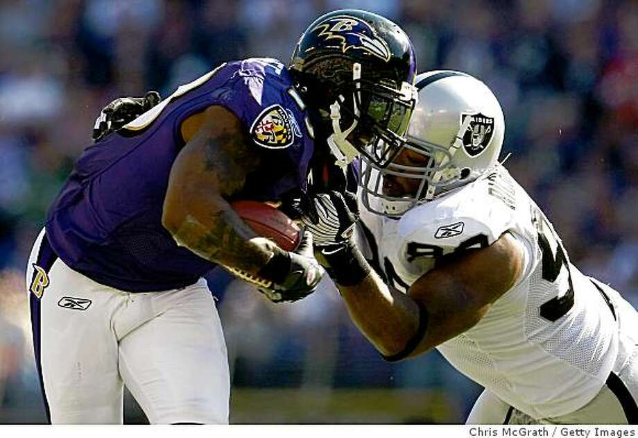 BALTIMORE - OCTOBER 26:  Willis McGahee #23 of the Baltimore Ravens fends off Jay Richardson #98 of the Oakland Raiders during the game at M&T Bank Stadium October 26, 2008 in Baltimore, Maryland.  (Photo by Chris McGrath/Getty Images) Photo: Chris McGrath, Getty Images