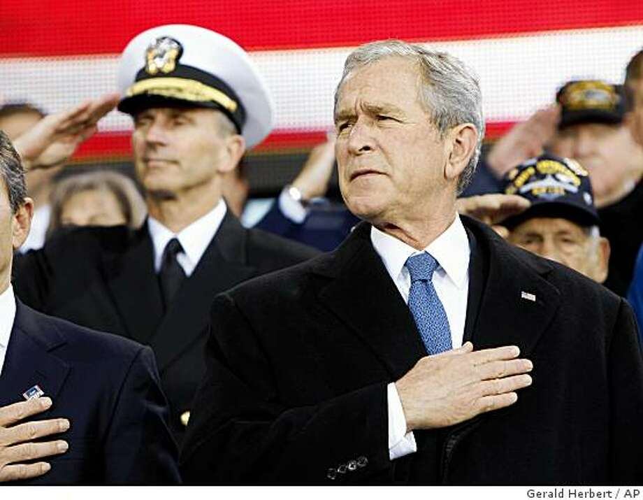 President Bush holds his hand to his heart during the playing of the National Anthem at the start of the rededication ceremony of the Intrepid Sea, Air and Space Museum  in New York, Tuesday, Nov. 11, 2008.  (AP Photo/Gerald Herbert) Photo: Gerald Herbert, AP