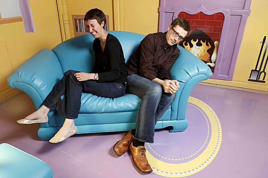 Tashana Landray, left  and Angus MacLane clown around as they cuddle up on the couch in Ken's Dream House, at the Pixar Studios,  Wednesday June 09, 2010, in Emeryville, Calif. THe couple both work for Pixar and contributed to the movie Toy Story 3. Photo: Lacy Atkins, The Chronicle