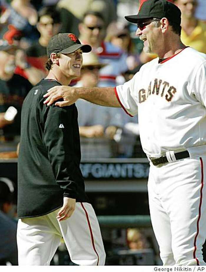 San Francisco Giants manager Bruce Bochy, right, pats pitcher Tim Lincecum on the shoulder after a game against the Los Angeles Dodgers, Sunday, Sept. 28, 2008, in San Francisco. Photo: George Nikitin, AP