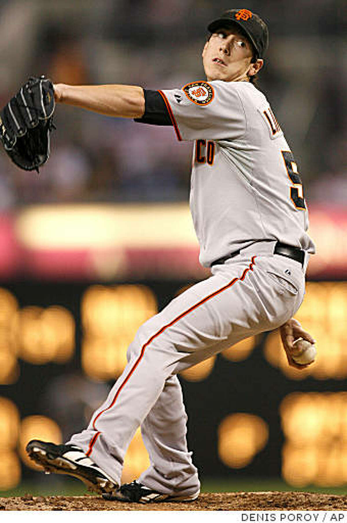 San Francisco Giants pitcher Tim Lincecum delivers during the first inning of a baseball game against the San Diego Padres, Saturday, Sept. 13, 2008, in San Diego. (AP Photo/Denis Poroy)