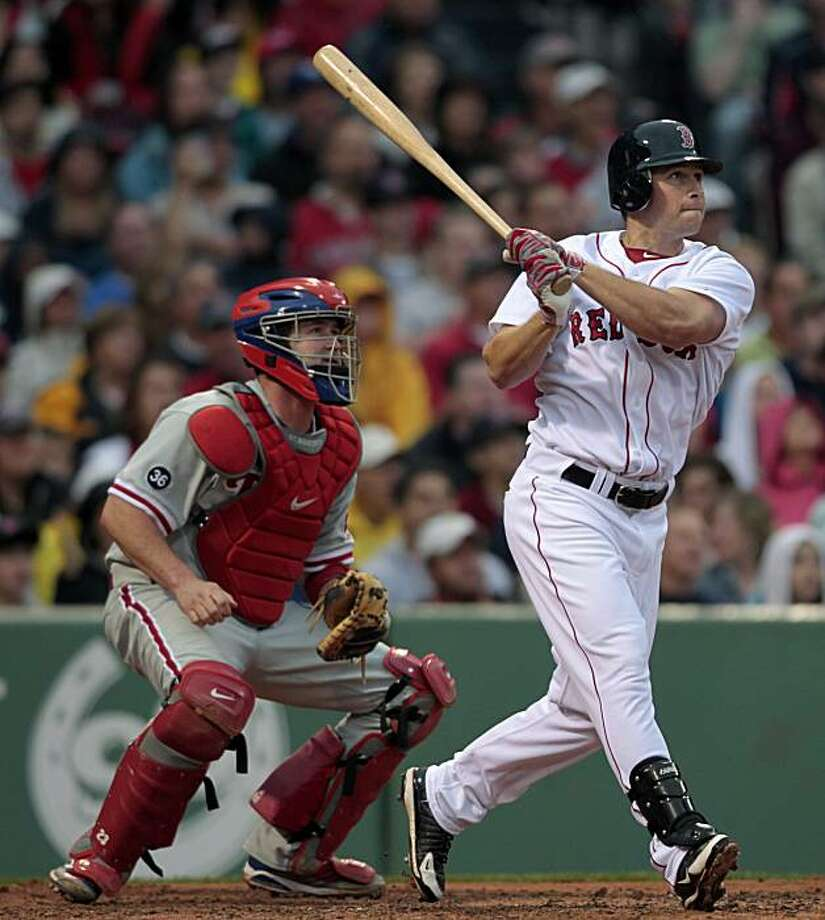 Boston Red Sox's Daniel Nava, right, watches his grand slam in front of Philadelphia Phillies' Brian Schneider in the second inning of a baseball game, Saturday, June 12, 2010, in Boston. Photo: Michael Dwyer, AP