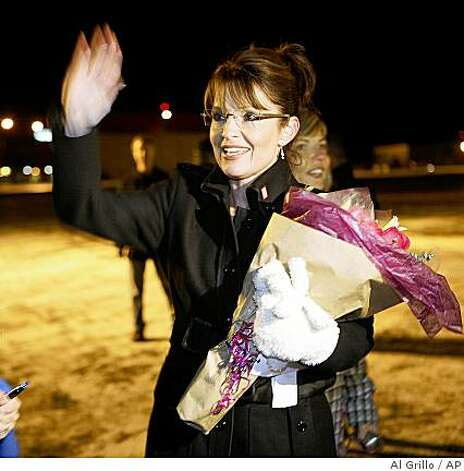 Alaska Gov. Sarah Palin greets supporters after returning to Anchorage, Alaska, Wednesday Nov. 5, 2008. Palin returned after 70 days on the campaign trail as Sen. John McCain's, R-Arriz., running-mate in the presidential election.  (AP Photo/Al Grillo) Photo: Al Grillo, AP