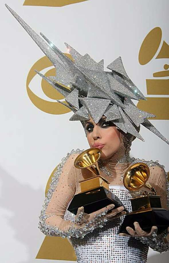 Lady Gaga poses with her awards during the 52nd annual Grammy Awards in Los Angeles, California on January 31, 2010. Photo: Valerie Macon, AFP/Getty Images