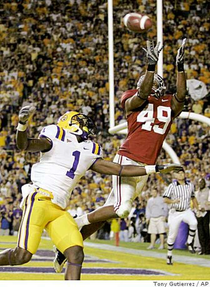 Alabama defensive back Rashad Johnson (49) intercepts a pass in the end zone intended for LSU wide receiver Brandon LaFell (1) during overtime of an NCAA college football game in Baton Rouge, La., Saturday, Nov. 8, 2008.  Alabama won in overtime 27-21. (AP Photo/Tony Gutierrez) Photo: Tony Gutierrez, AP