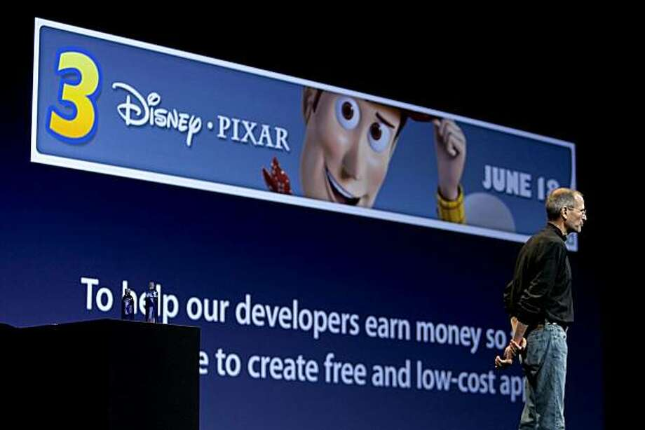 "Steve Jobs, chief executive officer of Apple Inc., talks about an advertisement for the ""Toy Story 3"" film using Apple's iAd platform on the iPhone 4 during his keynote address at the Apple Worldwide Developers Conference (WWDC) in San Francisco, California, U.S., on Monday, June 7, 2010. Jobs introduced the redesigned iPhone 4 , delivering a 24 percent thinner body and 100 new features. Photographer: David Paul Morris/Bloomberg *** Local Caption *** Steve Jobs Photo: David Paul Morris, Bloomberg"