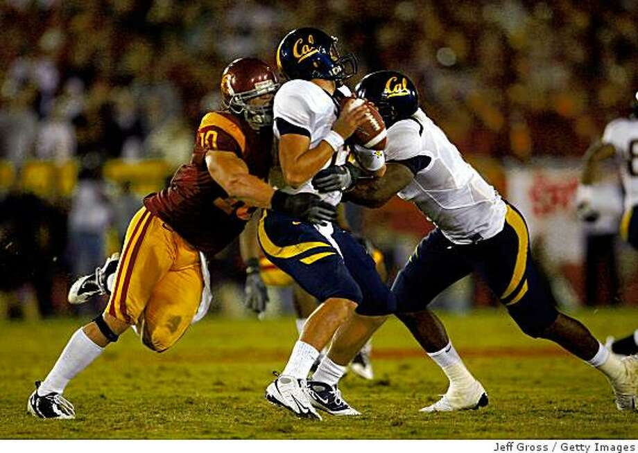 LOS ANGELES, CA - NOVEMBER 08:  Quarterback Kevin Riley #13 of the Cal Golden Bears is sacked by Brian Cushing #10 of the USC Trojans during the fourth quarter at the Memorial Coliseum on November 8, 2008 in Los Angeles, California. USC defeated Cal 17-3.  (Photo by Jeff Gross/Getty Images) Photo: Jeff Gross, Getty Images