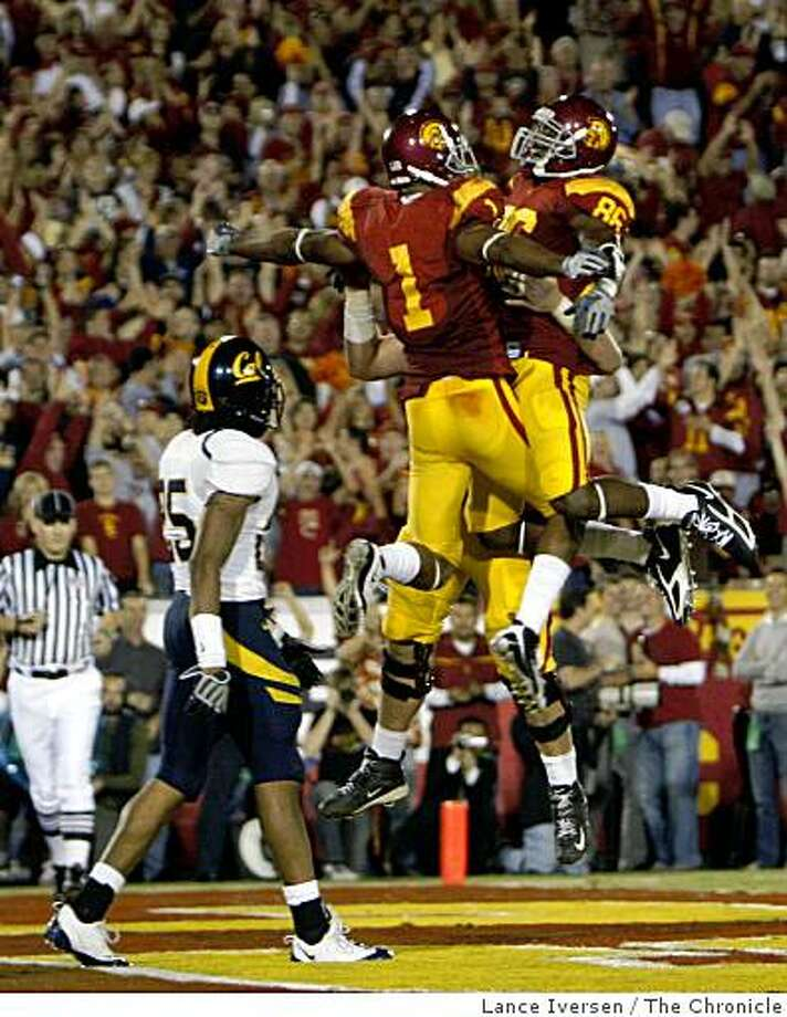 USC's Patrick Turner celebrates his touchdown reception with Anthony McCoy as Cal's Brett Johnson looks on. USC beat Cal 17-3 in Los Angeles, Calif., on Saturday, November 8, 2008. Photo: Lance Iversen, The Chronicle