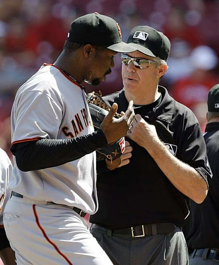 San Francisco Giants reliever Guillermo Mota, left, complains to umpire Gary Darling about a play in the eighth inning of a baseball game against the Cincinnati Reds, Thursday, June 10, 2010, in Cincinnati. Mota was the losing pitcher in the game won by Cincinnati 7-6. Photo: Al Behrman, AP