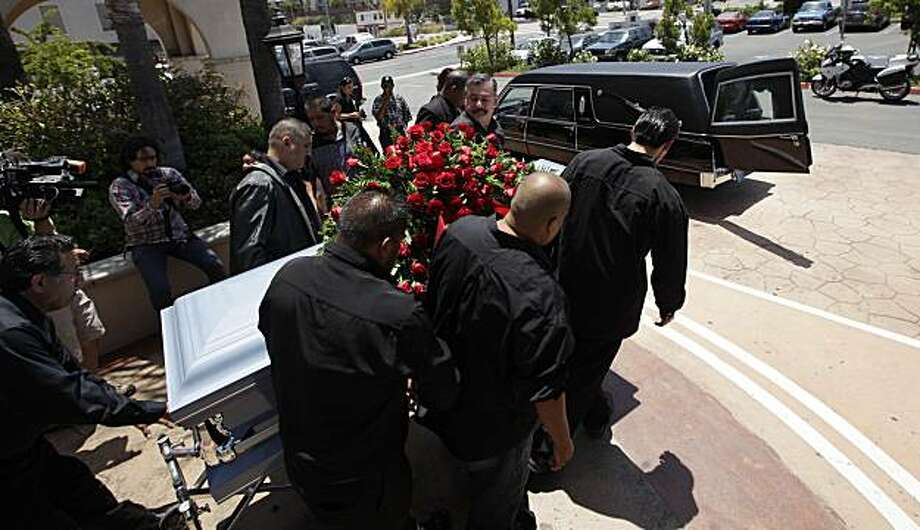 Relatives and friends of Anastasio Hernandez carry his casket away from a church after funeral services Wednesday, June 9, 2010 in San Diego. Hernandez died May 28 after being shocked by a stun gun during a fight with U.S. Border Patrol agents as they were escorting him to a border gate to return him to Mexico. Photo: Gregory Bull, AP
