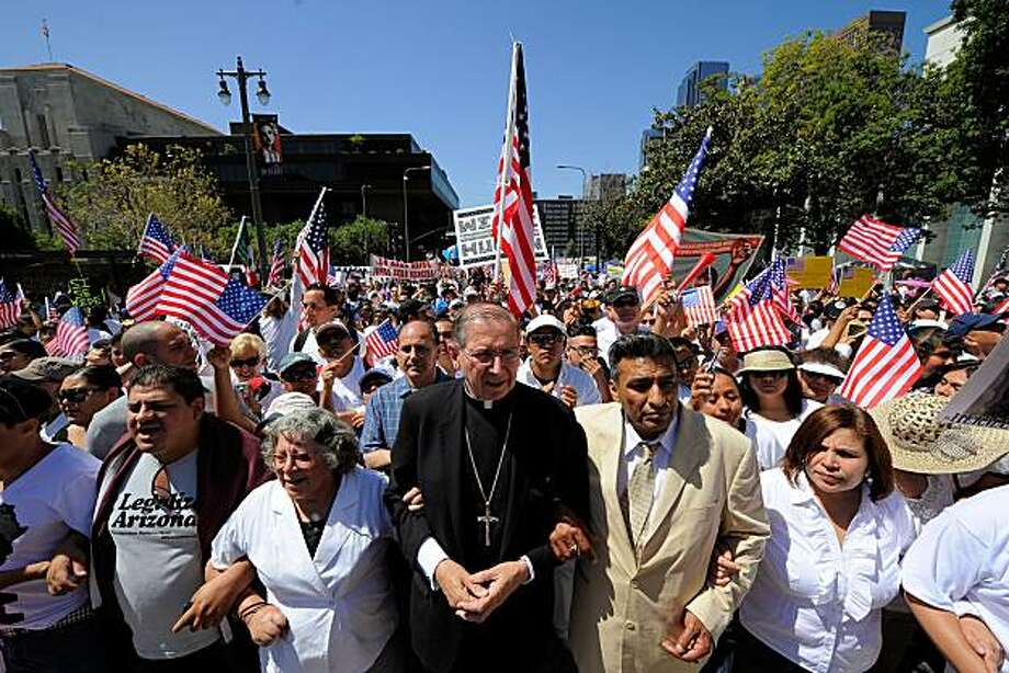 LOS ANGELES, CA - MAY 01: Los Angeles Cardinal Roger Mahony (C) joins thousands of demonstrators as they march during a May Day immigration rally on May 1, 2010 in Los Angeles, California. More than 100,000 people were expected to march from four directions towards Los Angeles City Hall to protest Arizona's new immigration law. Photo: Kevork Djansezian, Getty Images