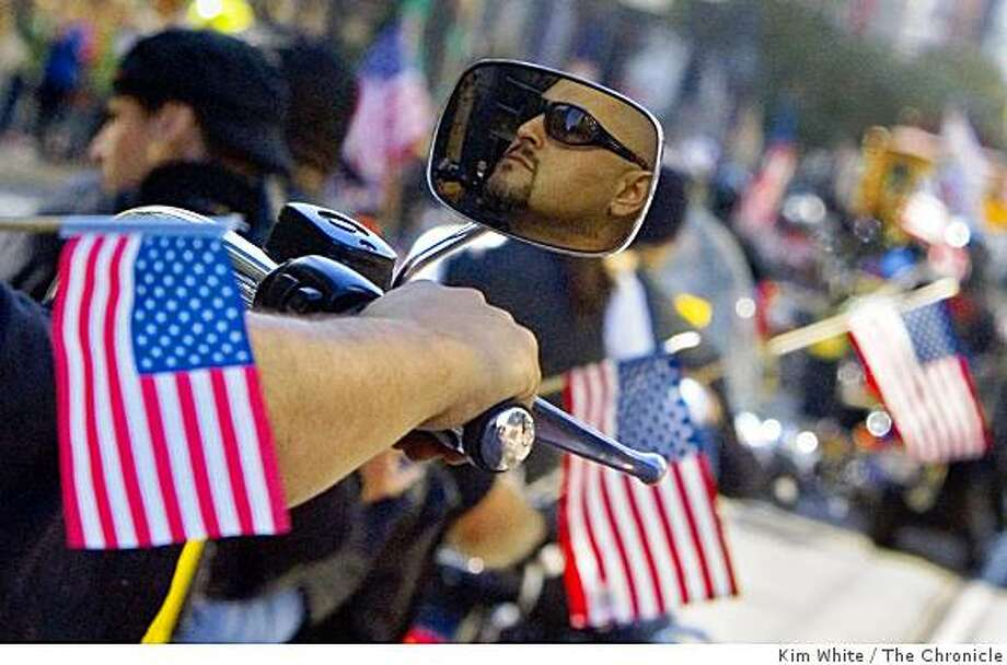 A war veteran rides his motorcycle in a veterans day parade in San Francisco , Calif., on Sunday, November 9, 2008. Photo: Kim White, The Chronicle