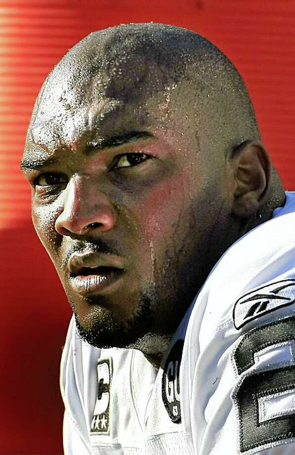 JaMarcus Russell OB of the Oaklands Raiders watches his team in the closing munutes of the game go down in defeat against the Baltimore Ravens 29-10 at the M&T Bank Stadium, Baltimore, MD on Sunday October 26, 2008. Photo: Frederic Larson, The Chronicle
