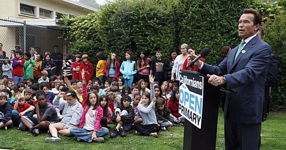 California Gov. Arnold Schwarzenegger talks to reporters and students at Kenter Canyon Elementary School in the Brentwood district of Los Angeles Tuesday, June 8, 2010. Photo: Reed Saxon, Associated Press
