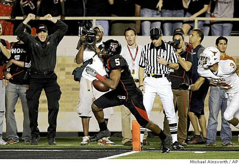 Texas Tech receiver Michael Crabtree scores the winning touchdown in the fourth quarter in front of Texas defender Curtis Brown in an NCAA college football game in Lubbock, Texas, on Saturday, Nov. 1, 2008. (AP Photo/The Dallas Morning News, Michael Ainsworth) ** MANDATORY CREDIT  MAGS OUT NO SALES  TV OUT  INTERNET: AP MEMBERS ONLY ** Photo: Michael Ainsworth, AP