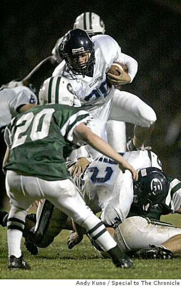 Bellarmine running back Douglass Tucker (28) leaps over guard Jacob Hickey (72) for a gain against Sacred Heart Cathedral Mark Mattais (20) during the third quarter at Kezar Stadium Friday November 7, 2008 in San Francisco, Calif. Photo: Andy Kuno, Special To The Chronicle