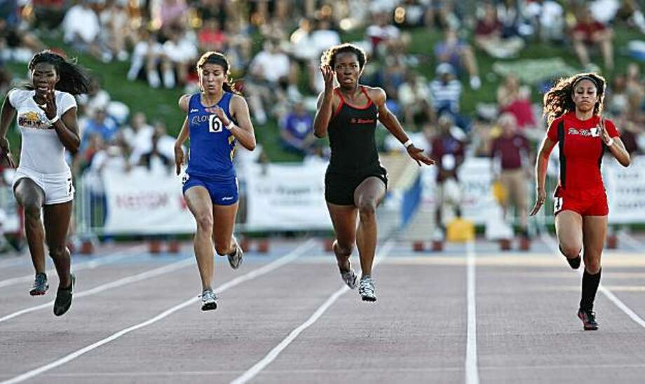 Ashton Purvis, center right, of St. Elizabeth in Oakland sprints to the finish to win the girls 100 meter dash at the 2010 California State High School Track and Field Championships in Clovis on Saturday. Photo: Michael Macor, The Chronicle