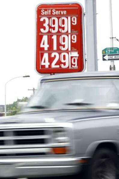 A car passes gas prices at a filling station Friday, May 27, 2011, in Philadelphia. For every $10 a