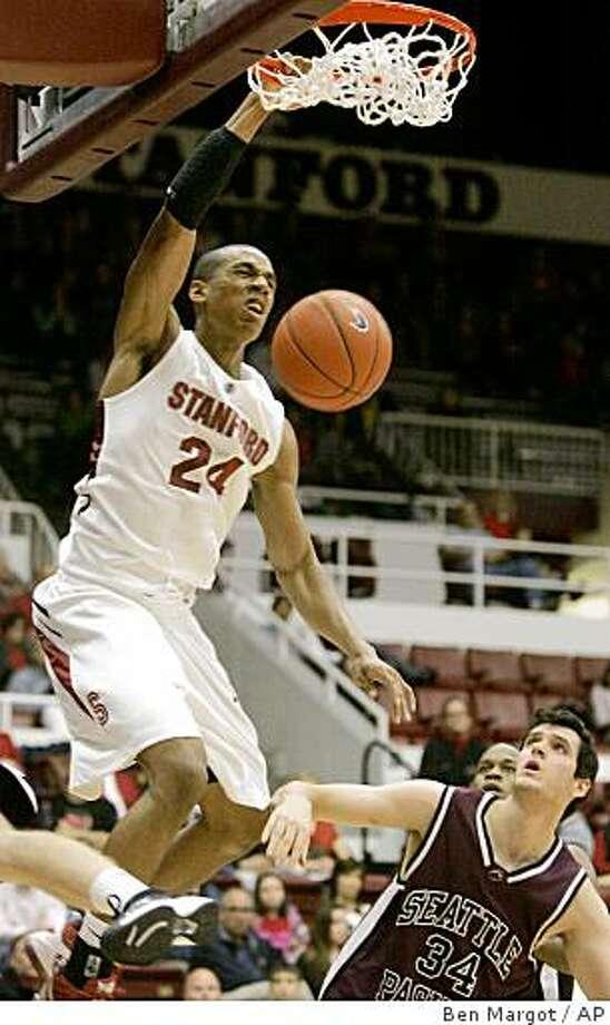 Stanford's Josh Owens (24) slams a basket over Seattle Pacific's Rafael Moreira (34) in the first half of an NCAA preseason college basketball game Saturday, Nov. 8, 2008, in Stanford, Calif. (AP Photo/Ben Margot) Photo: Ben Margot, AP