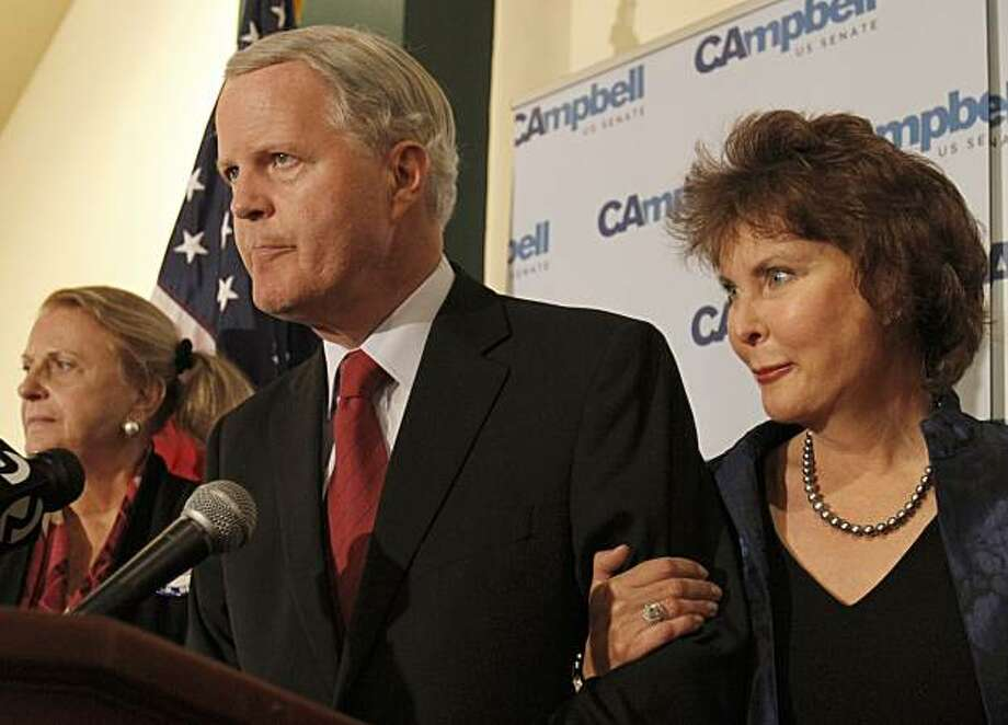 Tom Campbell, a candidate for the Republican nomination for the US Senate, concedes defeat to opponent Carly Fiorina during an election night rally Tuesday, June 8, 2010, in San Jose, Calif. Beside Campbell is his wife Susanne Campbell, right. Photo: Ben Margot, AP