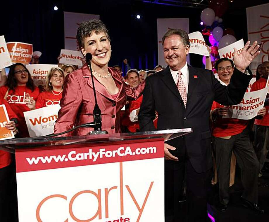 Carly Fiorina, a candidate for the Republican nomination for the U.S. Senate, waves to supporters with her husband Frank at a election night party in Anaheim, Calif., Tuesday, June 8, 2010. Photo: Chris Carlson, AP