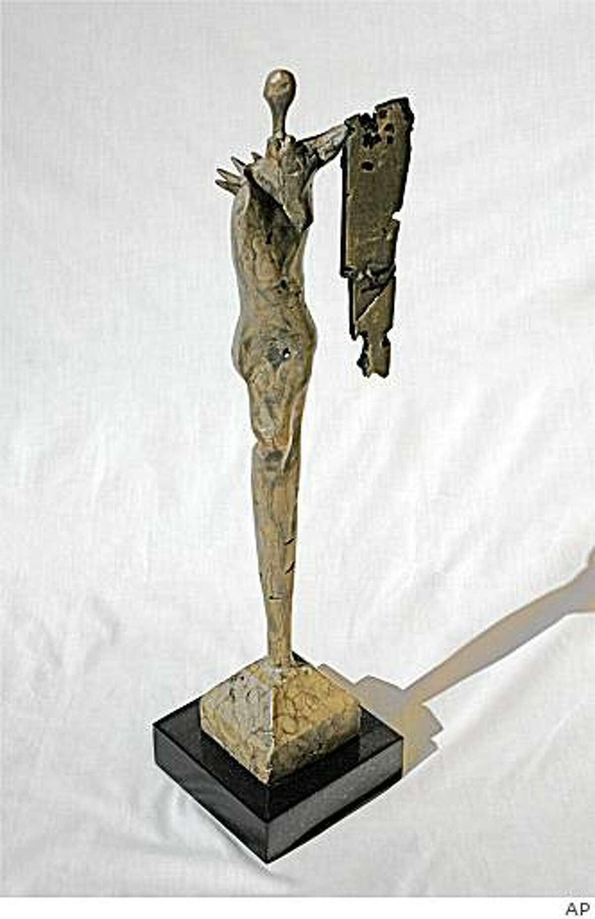 In this image released by Blair Hayes, a bronze abstract sculpture of a figure of a woman holding a shield created by actor Tony Dow, titled,