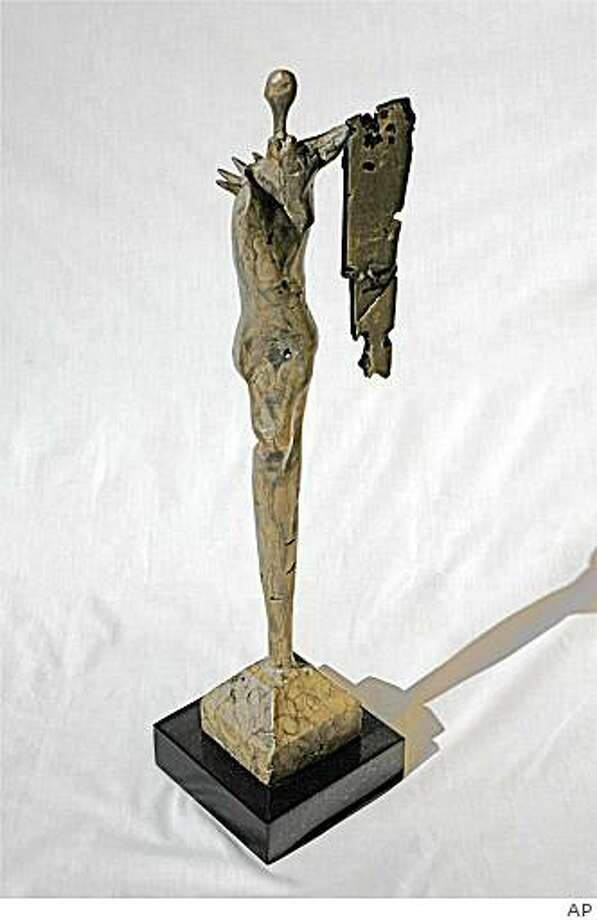 """In this image released by Blair Hayes, a bronze abstract sculpture of a figure of a woman holding a shield created by actor Tony Dow, titled, """"Unarmed Warrior,"""" is shown. Dow, best known for his role as Wally Cleaver, in the '50s TV series """"Leave It to Beaver,"""" will have one of his abstract sculptures on display at the Louvre from Dec. 11 to Dec. 14 .   (AP Photo/Blair Hayes) ** NO SALES ** Photo: AP"""