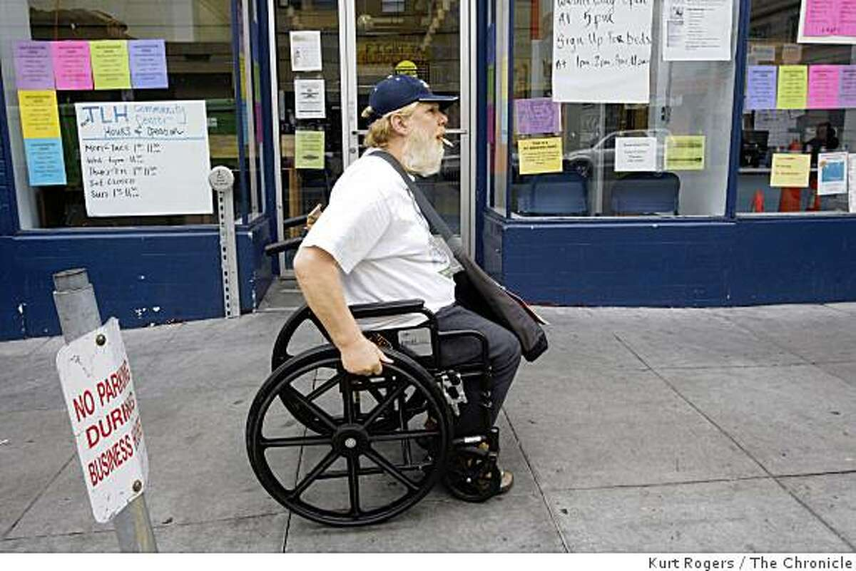 Rick Brandon, a 52-year-old Vietnam veteran, heads back to where he is staying on Golden Gate Avenue after receiving a gift pack for homeless veterans from the St. Anthony's Foundation on Tuesday Nov. 11, 2008 in San Francisco, Calif.