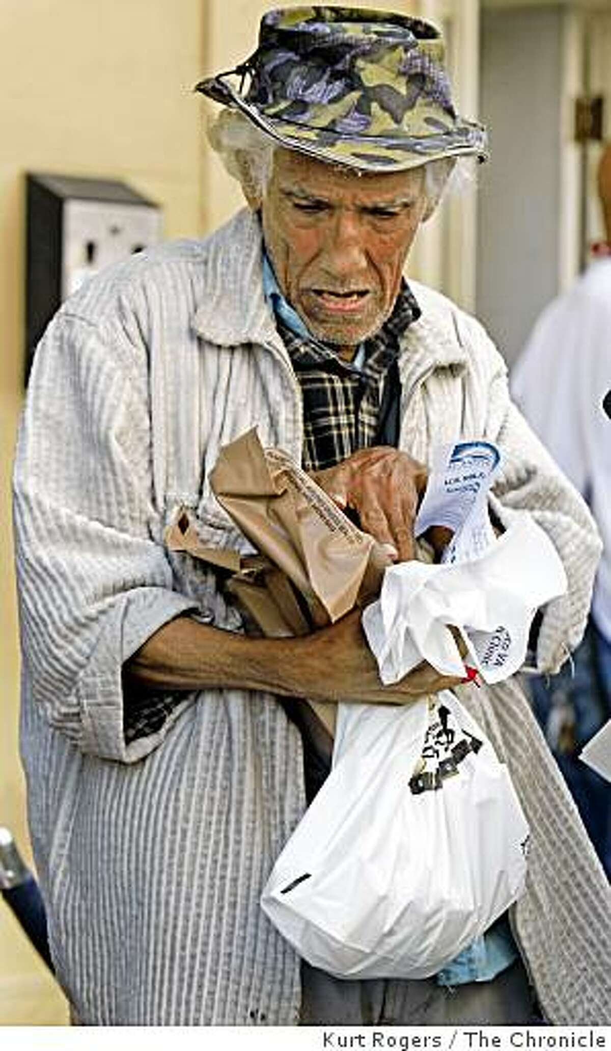 Alexandro Sedeno Leandro receives a gift pack from the St. Anthony's Foundation at a Veterans Day event on Tuesday Nov. 11, 2008 in San Francisco, Calif.