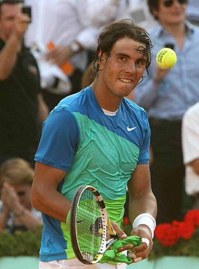 Spain's Rafael Nadal reacts after defeating Austria's Jurgen Melzer during their semifinal match for the French Open tennis tournament at the Roland Garros stadium in Paris, Friday, June 4, 2010. Photo: Lionel Cironneau, AP