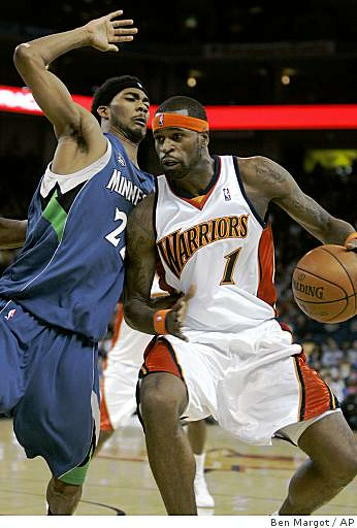 Golden State Warriors' Stephen Jackson (1) drives into Minnesota Timberwolves' Corey Brewer during the first half of an NBA basketball game Tuesday, Nov. 11, 2008, in Oakland, Calif. (AP Photo/Ben Margot)