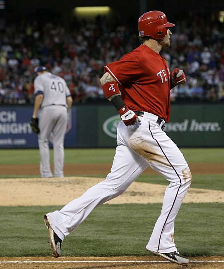 Texas Rangers's Josh Hamilton, foreground, trots  home after hitting a solo home run off of Tampa Bay Rays' Wade Davis, rear, in the fourth inning of a baseball game, Friday, June 4, 2010, in Irving, Texas. Photo: Tony Gutierrez, AP