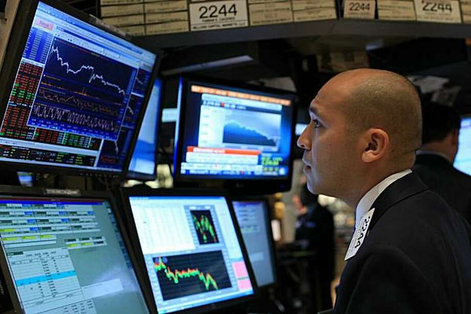 NEW YORK - JUNE 04:  A trader works on the floor of the New York Stock Exchange on June 4, 2010 in New York City. Stocks fell sharply on Friday following news of a new four-year low for the euro and a poorer than expected jobs report. The Dow Jones industrial average lost as much as 337 points in late afternoon trading. Photo: Spencer Platt, Getty Images
