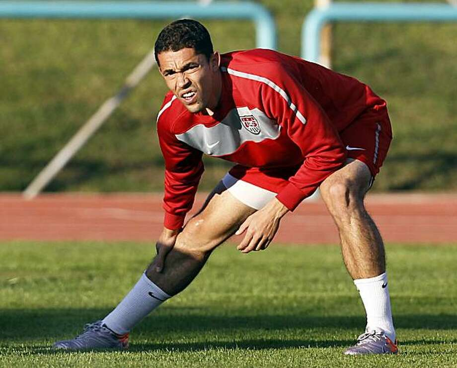 U.S. national soccer team forward Herculez Gomez stretches during training at Pilditch Stadium in Pretoria, South Africa,  Wednesday June 2, 2010. The U.S. team is preparing for the upcoming World Cup, which gets underway on June 11. Photo: Elise Amendola, AP