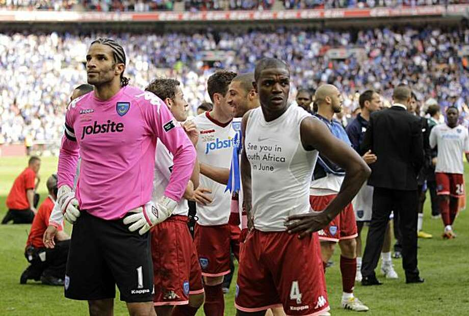 Portsmouth's Aaron Mokoena, right, and David James react after they lost the FA Cup final soccer match between Portsmouth and Chelsea at Wembley Stadium in London, Saturday May 15, 2010. Photo: Matt Dunham, AP