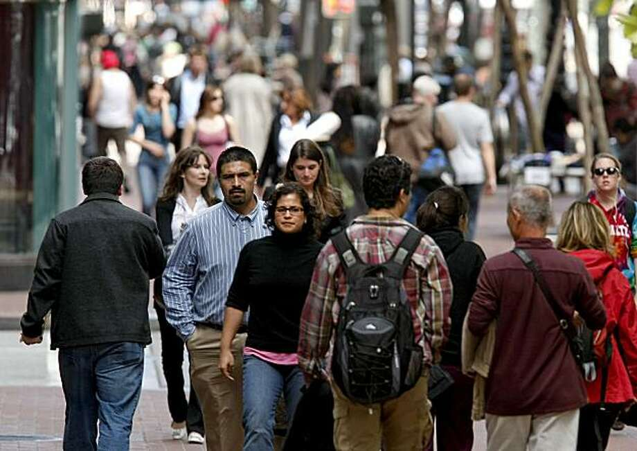 """People make their way along Market Street  in San Francisco, Calif. on Friday June 4, 2010. California's white population has undergone an """"unprecedented"""" decline since 2000 and is on the verge of being surpassed by Hispanics, according to new numbers from the state Department of Finance. Photo: Michael Macor, The Chronicle"""