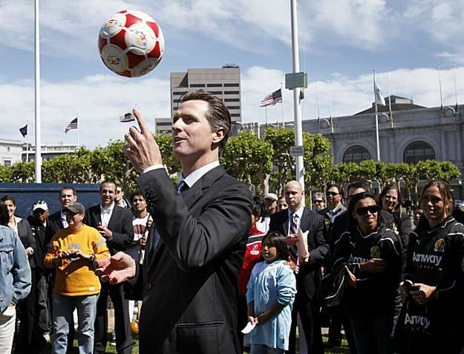 San Francisco Mayor Gavin Newsom toyed with a soccer ball at the Civic Center Plaza. San Francisco Mayor Gavin Newsom presided over a celebration of the upcoming 2010 World Cup soccer tourney at Civic Center Plaza Wednesday June 9, 2010. Photo: Brant Ward, The Chronicle