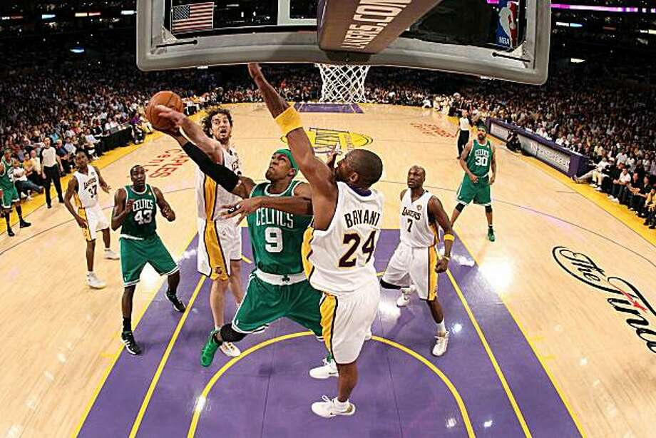 LOS ANGELES, CA - JUNE 06:  Rajon Rondo #9 of the Boston Celtics goes to the basket against Pau Gasol #16 and Kobe Bryant #24 of the Los Angeles Lakers in Game Two of the 2010 NBA Finals at Staples Center on June 6, 2010 in Los Angeles, California. NOTE TO USER: User expressly acknowledges and agrees that, by downloading and/or using this Photograph, user is consenting to the terms and conditions of the Getty Images License Agreement Photo: Christian Petersen, Getty Images