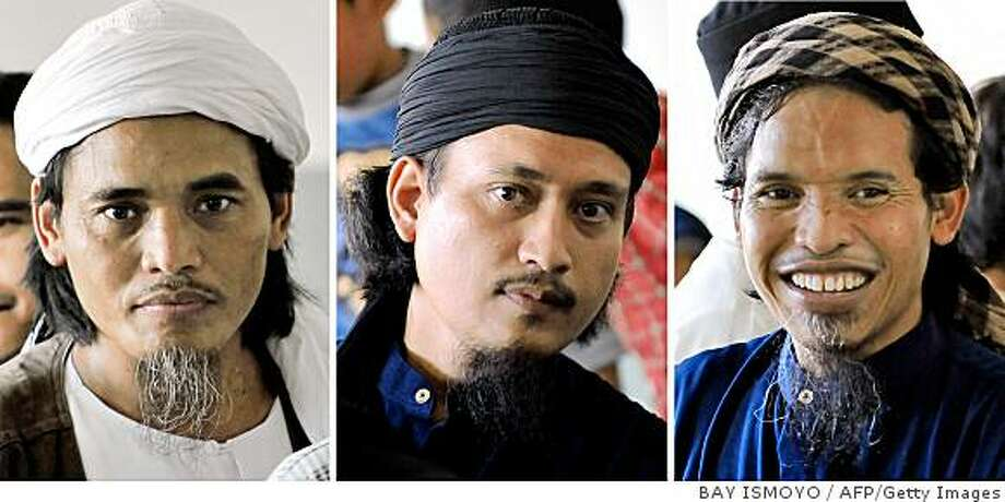 (FILES) This combo picture taken on March 26, 2008 shows convicted Bali bombers (L to R) Amrozi, Imam Samudra alias Abdul Aziz and Ali Ghufron alias Mukhlas at Batu prison on the Indonesian island of Nusa Kambangan. The three men, sentenced to death for the Bali bombings which killed 202 people, were executed by firing squad at midnight on the night of November 8, 2008 local television reported. Amrozi, 47, his brother Mukhlas, 48, and ringleader Imam Samudra, 38, were killed with shots to the heart on the island prison of Nusakambangan off southern Java, TV One television reported quoting an official source. AFP PHOTO/Bay ISMOYO (Photo credit should read BAY ISMOYO/AFP/Getty Images) Photo: BAY ISMOYO, AFP/Getty Images