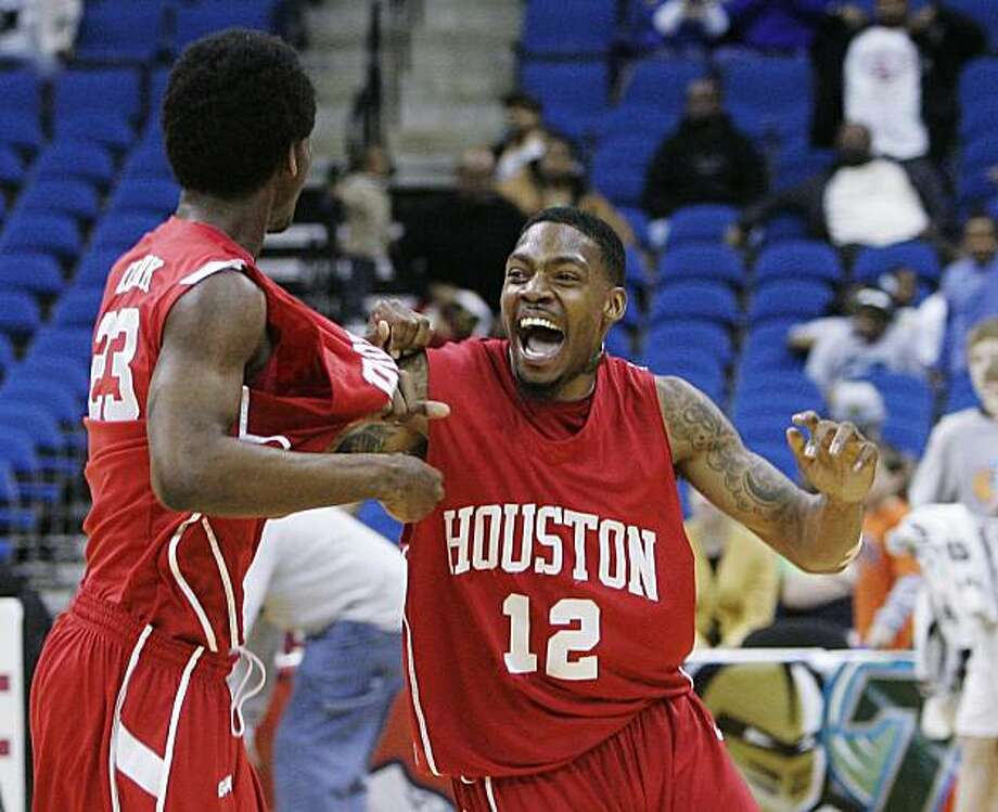 Houston guard Aubrey Coleman, right, celebrates with teammate forwrd Bryce Clark, left, after Houston defeated UTEP 81-73 in the CUSA men's championship NCAA college basketball game in Tulsa, Okla., Saturday, March 13, 2010. Photo: Sue Ogrocki, AP