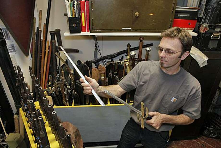 "Stagehand Jeff Johnson with his prop sword for SF Opera's production of ""Faust"" Photo: Cory Weaver"
