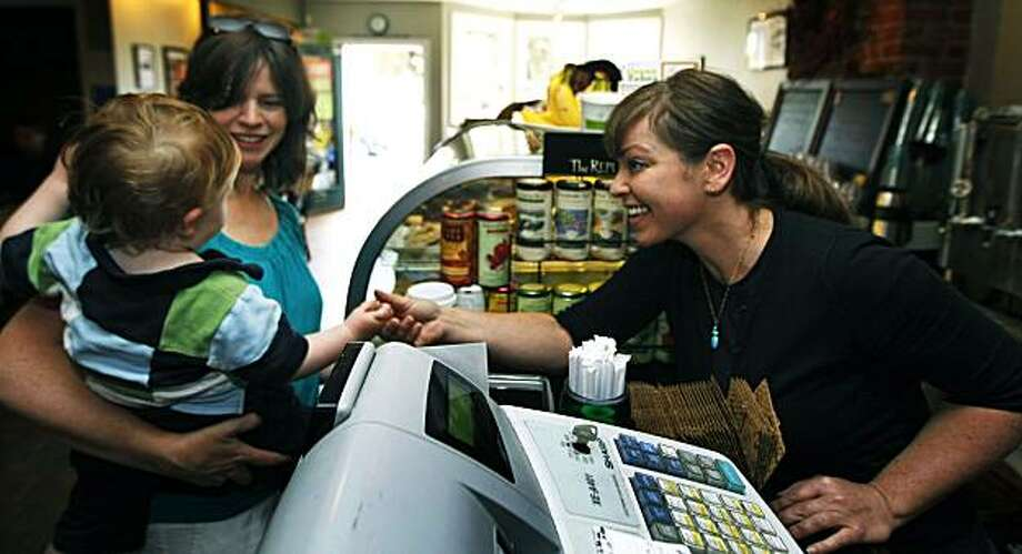 Bernie Melvin owner-operator of Bernie's neighborhood coffee shop right greets young customers Thursday June 3, 2010. Bernie's located on the bottom floor of big green Victorian on 24th St, in Noe Valley opened her shop almost directly across the street from a Starbucks. She's a woman running her own business, loves what she does and is living a dream she hatched when she worked there and it was still part of the Tully's chain. Photo: Lance Iversen, The Chronicle